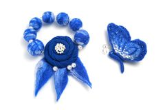 Blue bracelet and brooch in the form of a butterfly handmade on a white background.  Stock Photo