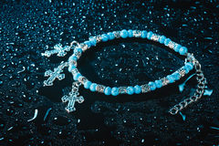 Blue bracelet with drops of water Stock Image