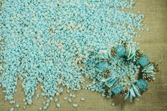 Blue bracelet with shells on the scattered blue gravel with pearl beads. Stock Photography