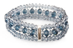 Blue bracelet on white Stock Photos
