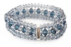 Blue bracelet on white Stock Photos
