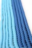 Blue bracelet on a white background Stock Photos