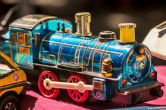 Blue brass vintage toy train stock photo
