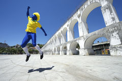 Blue Brazilian Football Player Jumping at Lapa Rio Stock Images