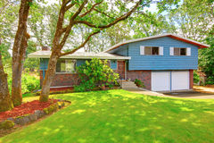 Blue brick American rambler exterior with nice front garden. Stock Photo