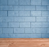 Blue brick background and wooden floor Royalty Free Stock Photo