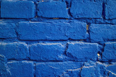 Blue brick. Old wall with blue painting brick Stock Photography