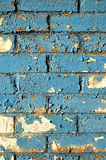 Blue Brick Wall. A background of a brick wall with layers of blue and white paint peeling off royalty free stock photography