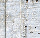 Blue Brick Wall. Old brick wall with peeling blue paint Royalty Free Stock Photography