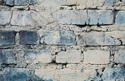 Blue brick wall with cracks and scuffs, urban loft background royalty free stock images