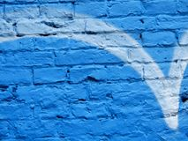 Blue brick wall with graffiti. Brick wall blue with graffiti painted used as background texture pattern Stock Photos