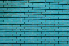 Blue brick wall new dirt royalty free stock photography