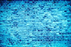 Blue brick wall painted with different tones and hues of blue as seamless pattern texture background.  royalty free stock image