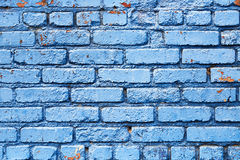 Blue Brick Wall with peeling paint background texture. Brick wall that has been painted blue with peeling paint used as background texture pattern