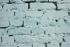 Blue Brick Wall with peeling paint background texture Stock Photo