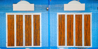 Blue bricks and bamboo door Royalty Free Stock Images