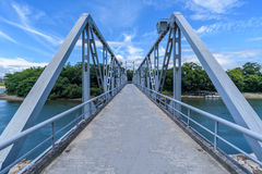 Blue bridge across Asahi River from Okayama Castle, Japan. Blue bridge across Asahi River from Okayama Castle to Korakuen Garden Stock Photo