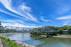 Blue bridge across Asahi River from Okayama Castle to Korakuen G. Arden in Japan Stock Images
