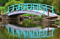 Blue Bridge Over Pond royalty free stock images
