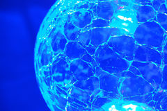 Blue bright crystal ball. Close of a Blue bright crystal ball Stock Photography