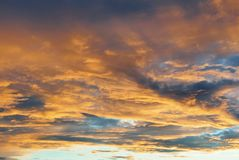 Blue bright evening morning sky with dramatic colorful yellow or Royalty Free Stock Photos