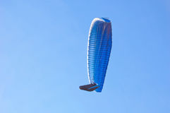 Blue bright Paragliders in blue sky. Paraglider in blue sky. Sport and hobby Stock Photos