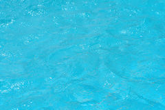 Blue and bright ripple water and surface in swimming pool Royalty Free Stock Photos