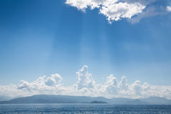 Blue bright sky background on the ocean with clouds and emotiona Royalty Free Stock Photography