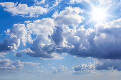 Blue bright sky. Blue sky with sun, sunbeams and clouds Royalty Free Stock Image