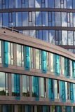 Blue brise soleil sun breakers on modern office glass building Royalty Free Stock Image