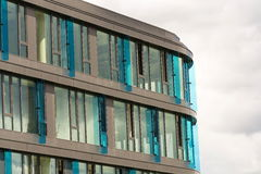 Blue brise soleil sun breakers on modern office glass building Stock Images