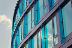 Blue brise soleil sun breakers on modern office glass building Royalty Free Stock Photography
