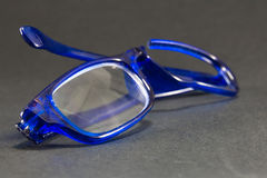 Blue broken glasses on black background Stock Photography