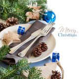 Blue and brown Christmas table setting with rustic decorations Stock Photos