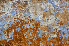 Blue and brown color, detail of a house facade. With peeling paint, for use as a background Royalty Free Stock Photography