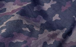 Blue and brown color military uniform pattern with blur effect. Stock Photography