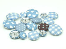 Blue and brown fabric buttons isolated Stock Photos