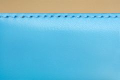 Blue and brown leather. Natural blue and brown leather background closeup Royalty Free Stock Images