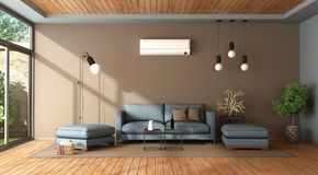 Blue and brown living room with air conditioner Stock Photos