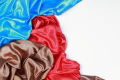 Blue and brown and red silk satin cloth of wavy folds texture ba Royalty Free Stock Photos
