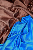 Blue and brown Silk cloth of wavy abstract backgrounds Royalty Free Stock Photos