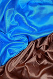 Blue and brown Silk cloth of wavy abstract backgrounds Stock Image