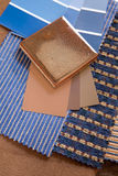 Blue and brown swatches with a ceramic tile. Blue and brown paint color and fabric swatches with a ceramic floor tile Stock Photography