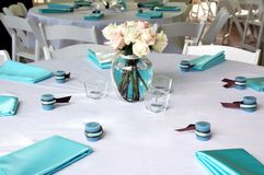 Blue & Brown Table Setting 2. A table for six with candles, roses and napkins Royalty Free Stock Photos