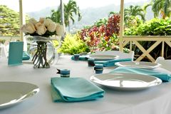 Blue & Brown Table Setting. Table setting for an informal wedding in a tropical setting Royalty Free Stock Photo
