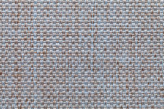 Blue and brown textile background with checkered pattern, closeup. Structure of the fabric macro. Stock Photos