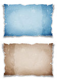 Blue and brown torn papers Stock Photos