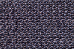 Blue and brown vintage fabric with woven texture closeup. Textile macro background Royalty Free Stock Photography