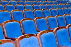 Blue brown wooden chairs in the auditorium. Without people Royalty Free Stock Image