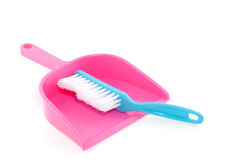 A blue brush and a pink brushpan Royalty Free Stock Image